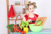 Young attractive housewife with vegetables — Stockfoto