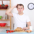 Thoughtful man in the kitchen — Stock Photo