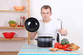 Funny man cooking in the kitchen — Stock Photo
