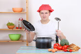 Young man having fun in the kitchen — Stock Photo