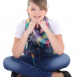 Teenage girl sitting over white — Stock Photo