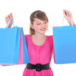 Picture of happy teenage girl in pink with shopping bags — Stock Photo