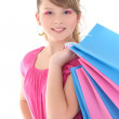 Stock Photo: Portrait of happy teenage girl with shopping bags