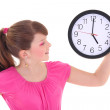 Portrait of beautiful teenage girl with clock isolated over whit — Stock Photo #19530837