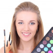 Young woman with eyeshadow makeup palette  — ストック写真