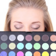 Young woman with eyeshadow palette — Stock Photo #19836131