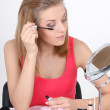Stock Photo: Beautiful blonde with make up accessories and mirror