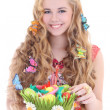 Beautiful girl holding basket with Easter eggs — Stock Photo