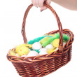 Basket with easter eggs in female hand — Stock Photo