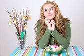 Dreaming teenage girl with easter eggs and pussy-willow — Stock Photo