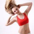 Sporty woman with long blowing hair over white — Stock Photo