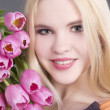 Stock Photo: Attractive blondie girl with tulips