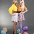 Smiling teenage girls with colorful balloons  — Stock Photo
