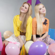 Teenage girls sitting with colorful balloons — Stock Photo