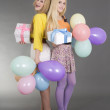 Teenage girls with gifts and balloons at a birthday party — Stock Photo