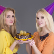 Beautiful girls with birthday cake — Stock Photo