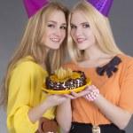 Portrait of beautiful girls with birthday cake — Stock Photo #21247127