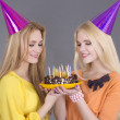 Portrait of two friends with birthday cake — Stock Photo