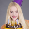 Young attractive woman with birthday cake — Stock Photo #21247141