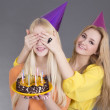 Teenage girls with birthday cake — Stock Photo