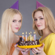 Teenage girls with chochlate birthday cake — Stock Photo #21247155