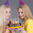Beautiful teenage girls with birthday cake — Stock Photo