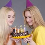 Beautiful teenage girls with birthday cake — Stock Photo