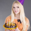Teenage girl with birthday cake — ストック写真