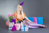 Portrait of beautiful blondie girl with gifts and flowers — Stok fotoğraf