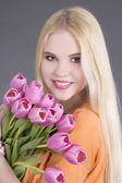 Beautiful blondie girl with tulips — Stock Photo