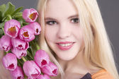 Attractive blondie girl with tulips — Stock Photo