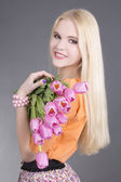 Portrait of beautiful blondie girl with tulips — Stock Photo