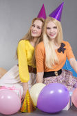 Teenage girls with balloons at a birthday party — Stock Photo