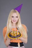 Young woman with birthday cake — Stock Photo