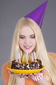 Young attractive woman with birthday cake — Stock Photo
