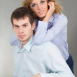 Young beautiful couple in studio - Stock Photo