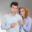 Young attractive couple with glasses of champagne — Stock Photo