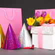 Tulips, gift boxes and birtday hats - Stock Photo