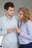 Man and woman with glasses of champagne — Stock Photo