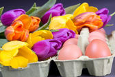 Easter eggs with colorful tulips — Stock Photo
