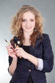 Young beautiful woman with make up brushes — Stock Photo