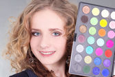 Young beautiful woman with make up palette — Stock Photo