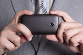 Cellphone camera in male hands — Stock Photo