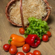 Fresh vegetables and wooden basket — Stock Photo