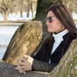 Royalty-Free Stock Photo: Young attractive woman with sunglasses in park