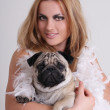Young woman with pug dog — Stock Photo #23236578