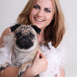 Portrait of young woman with pug dog — Stock Photo