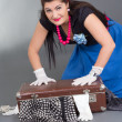Funny pinup girl with overfilled suitcase — Stock Photo