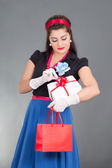 Beautiful pinup girl with presents — Stock Photo