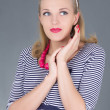 Dreaming pinup girl in striped dress posing - Stock Photo